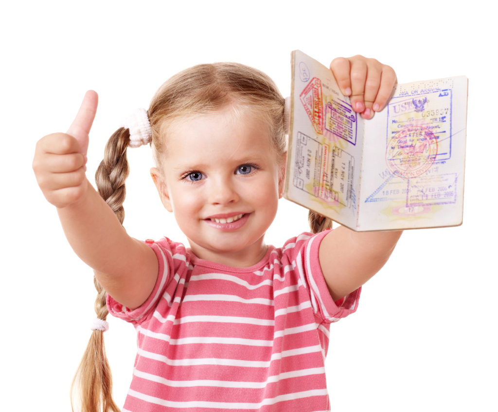 Young girl with passport