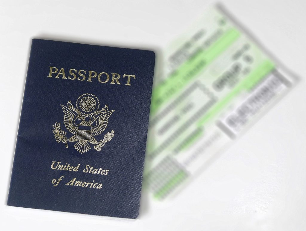 The passport renewal process - a photo of a passport and an airline ticket